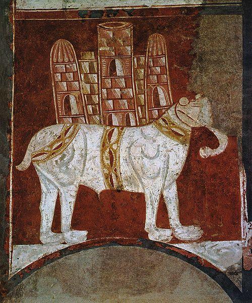 Weißer Elefant mit Burg auf dem Rücken